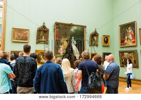 MOSCOW - CIRCA JULY, 2016: Visitors to the State Tretyakov Gallery art museum founded in 1856 by the merchant Pavel Tretyakov, and having one of the world's largest collection of Russian art.