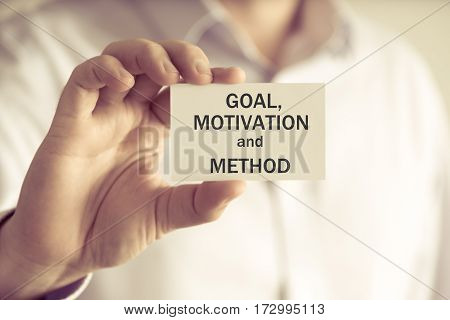 Businessman Holding Goal, Motivation And Method Message Card