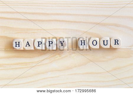 Happy Hour Top views word made from wooden letters on the table