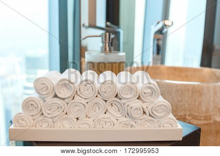 Close up towels with a soap dispenser accessories other in a bathroom