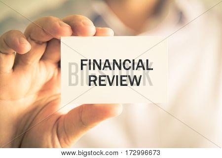 Businessman Holding Financial Review Message Card