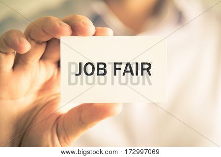 Businessman Holding Job Fair Message Card