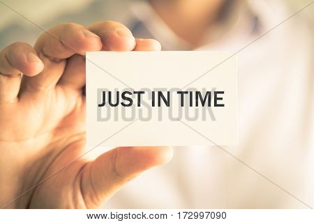 Businessman Holding Just In Time Message Card