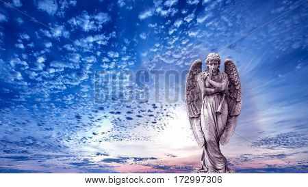 Angel sculpture on blue sky background panoramic view concept of Religion