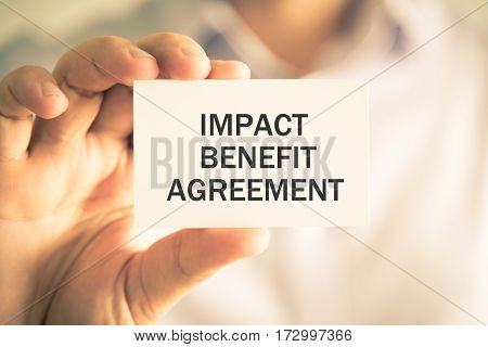 Businessman Holding Impact Benefit Agreement Message Card
