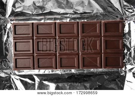 Chocolate bar on foil, closeup