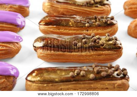 Group of delicious eclairs closeup
