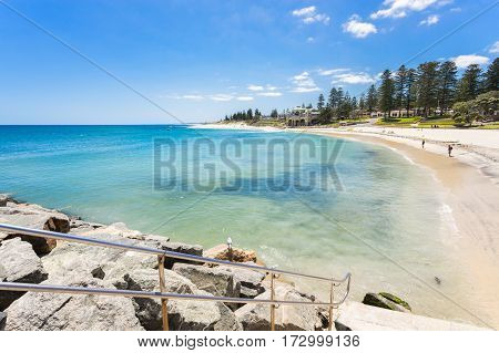 Cottesloe Beach and the Indiana Tea House on a summer day with a clear blue sky. Cottesloe Beach is a popular location for tourists to visit in Perth, Western Australia, Australia.