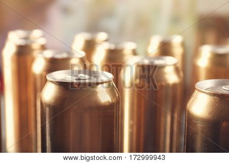 Cans of beer on blurred background
