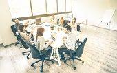 Group of young people employee coworkers at business meeting in urban coworking place studio - Human resources concept at working time - Start up entrepreneurs at office - Bright desaturated filter poster