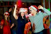 Young peoples Christmas party in the nightclub. Dancing on the dancefloor poster