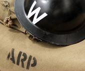 Air raid wardens helmet on canvas bag. poster