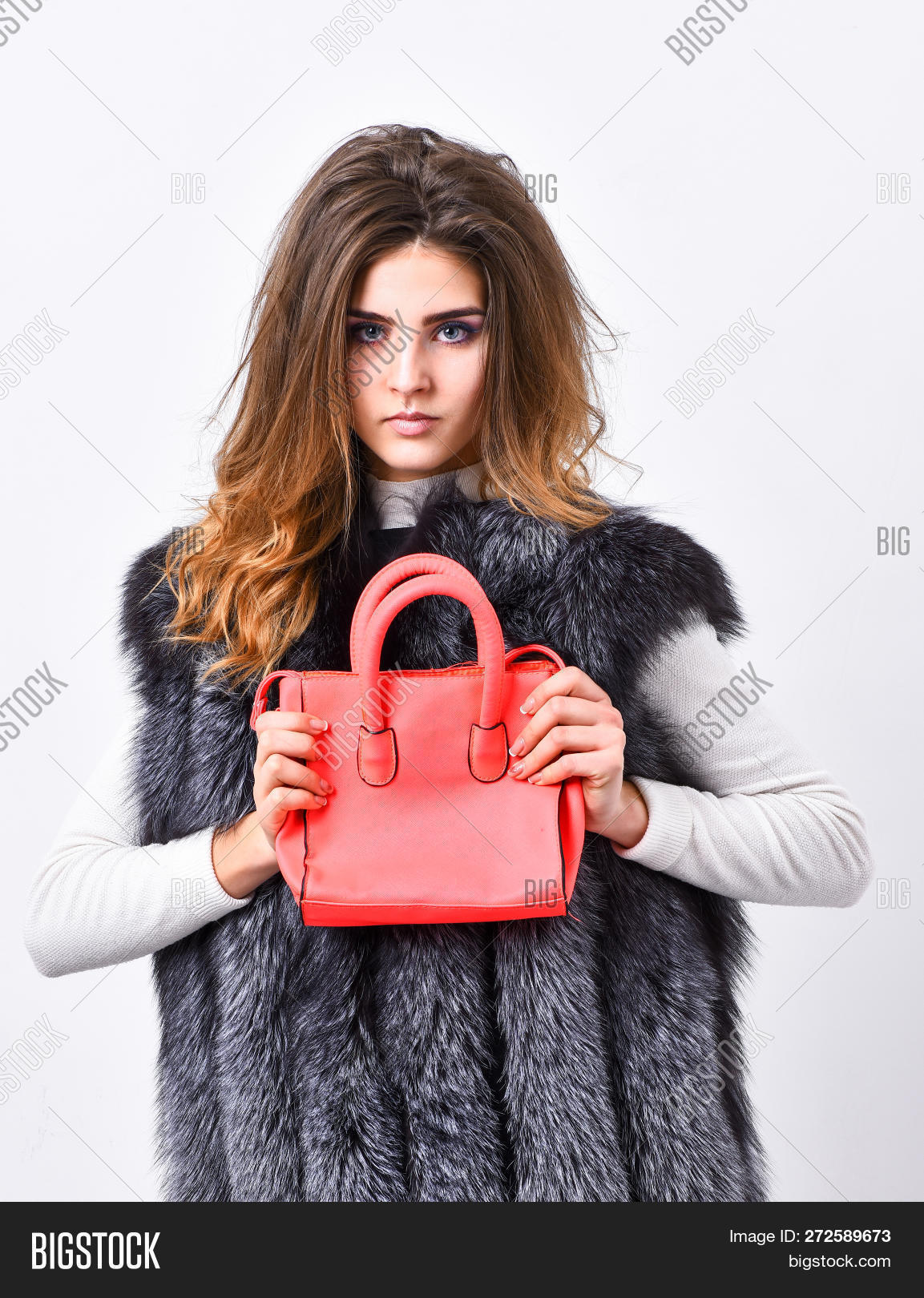 b6c06d23 Fashion and shopping concept. Female stylish fashion model. Woman in fur  coat with handbag on white background. Girl fashion lady stylish hairstyle  wear ...
