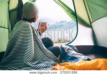 Young Woman Covered With Warm Plaid Meets Cold Morning In Sitting In A Touristic Camping Tent With A