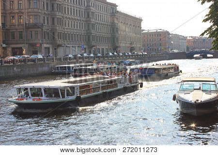 St. Petersburg, Russia - July 13, 2018: Excursion And Tour Cruise Boats On Neva River Water. Cruise