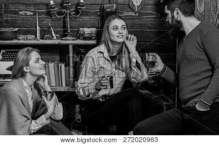 Family Enjoy Conversation In Gamekeepers House. Sincere Conversation Concept. Girls And Man On Happy