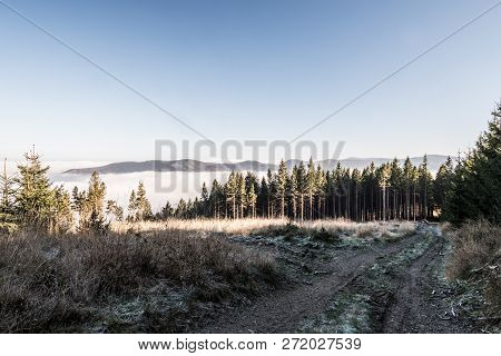 Late Autumn Mountain Scenery With Trail, Meadow, Trees, Mist In Lower Altitzdes, Hills And Clear Sky