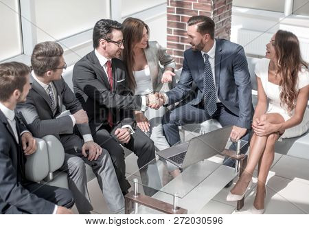 business colleagues greet each other at an informal meeting