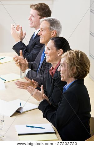 Business people clapping in meeting