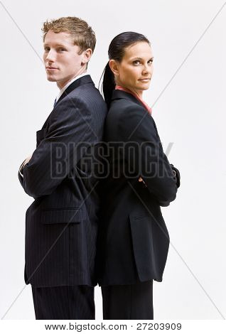 Business people standing back to back