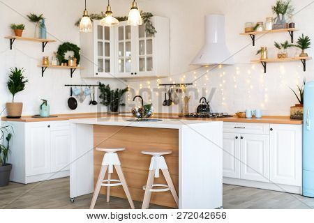 Modern Kitchen Interior With Island, Sink, Cabinets In New Luxury Home Decorated In Christmas Style