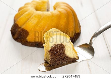 Group Of One Whole One Slice Of Fresh Baked Marble Gugelhupf Sweet Bread Variety One Piece Is In Foc