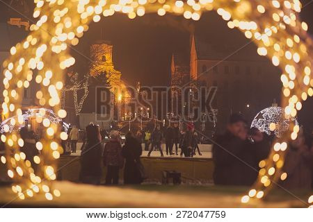 Ice Skaters On The Downtown Square In Gyor At Night
