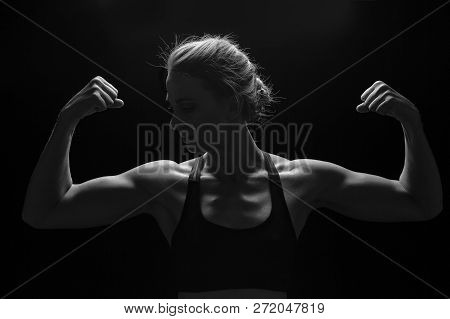 Fit Woman With Shaped Muscles On Her Arms In Artistic Conversion