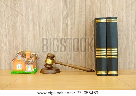 Judge Gavel Law Book & Home House Model On Wooden Desk. Real Estate Dispute & Property Auction Conce