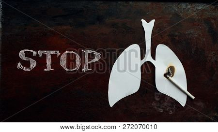 Stop Quit Smoking. Paper White Lungs With Burned Hole And Cigarette With Smoke On Dark Rusty Old Bac