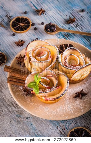 Crispy Apple Roses On Color Plate With Several Herbs And Spices