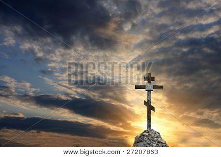 Cross on dramatic sky sunset background
