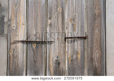 Texture of old wood of grey color with metal elements