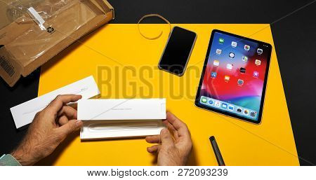 Paris, France - Nov 16, 2018: Man Unboxing Latest Ipad Pro Smart Tablet Device And Revealing The Box