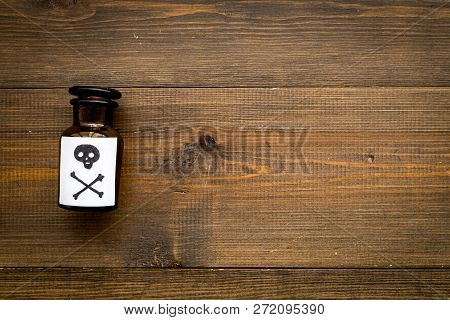 Dangerous Addictions, Dangerous Entertainment. Poison. Bottle With Skull And Crossbones On Dark Wood