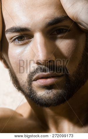 Male Face. Attractive Man. Handsome Young Man. Portrait Of A Sexy Guy. Confident Look. Men's Fashion