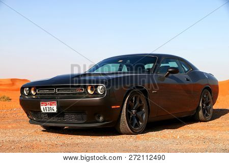 Fujairah, Uae - November 18, 2018: American Muscle Car Dodge Challenger In The Sand Desert.