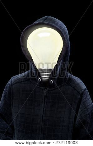 Mysterious Man Wearing Hoodie In Silhouette With A Light Bulb On His Head Isolated On Black Backgrou