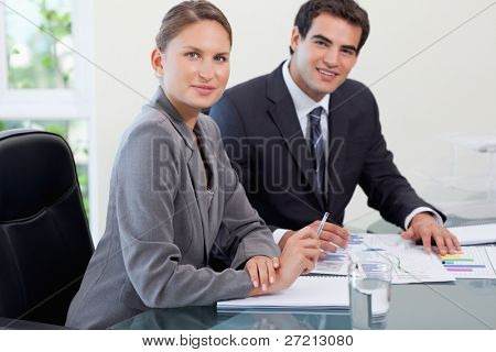 Young business team studying statistics in a meeting room