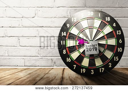 Notes Paper With Target 2019 Text In Dartboard On Wooden Table. Target 2019. Happy New Year 2019