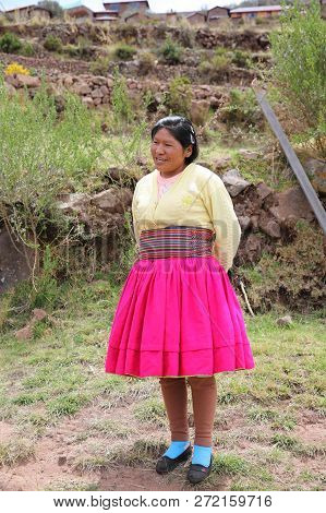 Puno, Peru - October 24, 2018: Unidentified Woman In Traditional Outfit Specific For The Taquile Isl