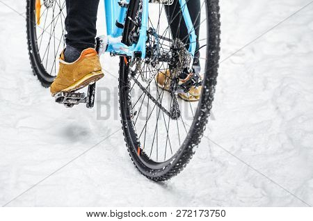 Cyclist On Cyclocross Bike Trails In The Snowy Forest In Winter. Winter Workout Outdoors Concept