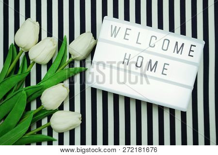 Welcome Home Light box letters Top view Flat Lay with tulip flower bouquet poster