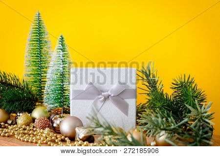 A Christmas decoration glass balls with fir trees on yellow background
