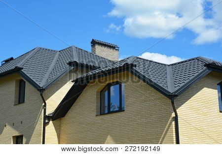 Brick House With Problem Roofing Construction And Roof Gutter Pipeline System. Roofing Construction.