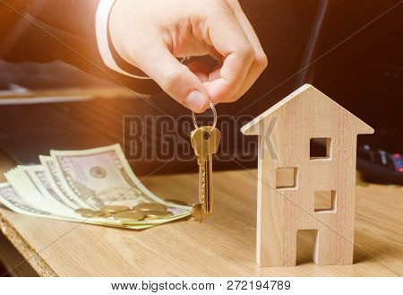 Realtor Holds House Keys. Real Estate Agent. Buying And Selling A House, Apartment. Home Rent. Affor