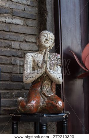 Statute Of A Buddhist Monk On A Stool, Religion