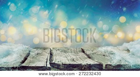 Winter Design.  Christmas Background With Frozen Wooden Table With Bokeh. Snow And Ice On Wooden Tab