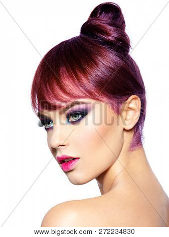 Closeup face of a beautiful woman with bright vivid  makeup. Fashion model with creative eye makeup - isolated on white. Girl with a ginger hair. Short hairstyle with fringe