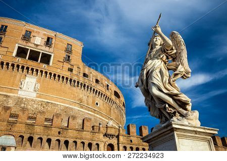 Angel Holding A Spear At Holy Angel Castle Aka Castel Santangelo In Rome, Italy.